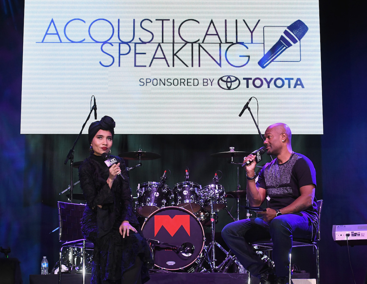 """LAS VEGAS, NV - NOVEMBER 03: Singer-songwriter Yuna (L) is interviewed by host/television personality Big Tigger during """"Acoustically Speaking Sponsored by Toyota"""" at the House of Blues during Soul Train Weekend on November 3, 2016 in Las Vegas, Nevada. (Photo by Paras Griffin/BET/Getty Images for BET)"""