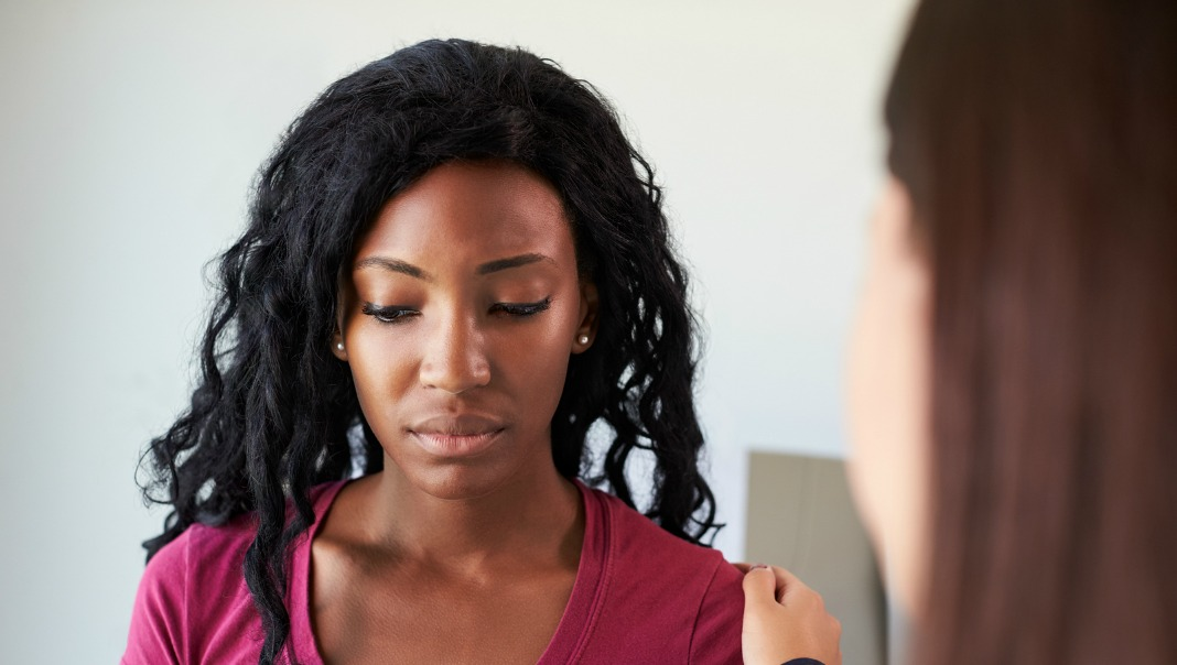 black woman at doctor, test results, cancer screening, colon cancer