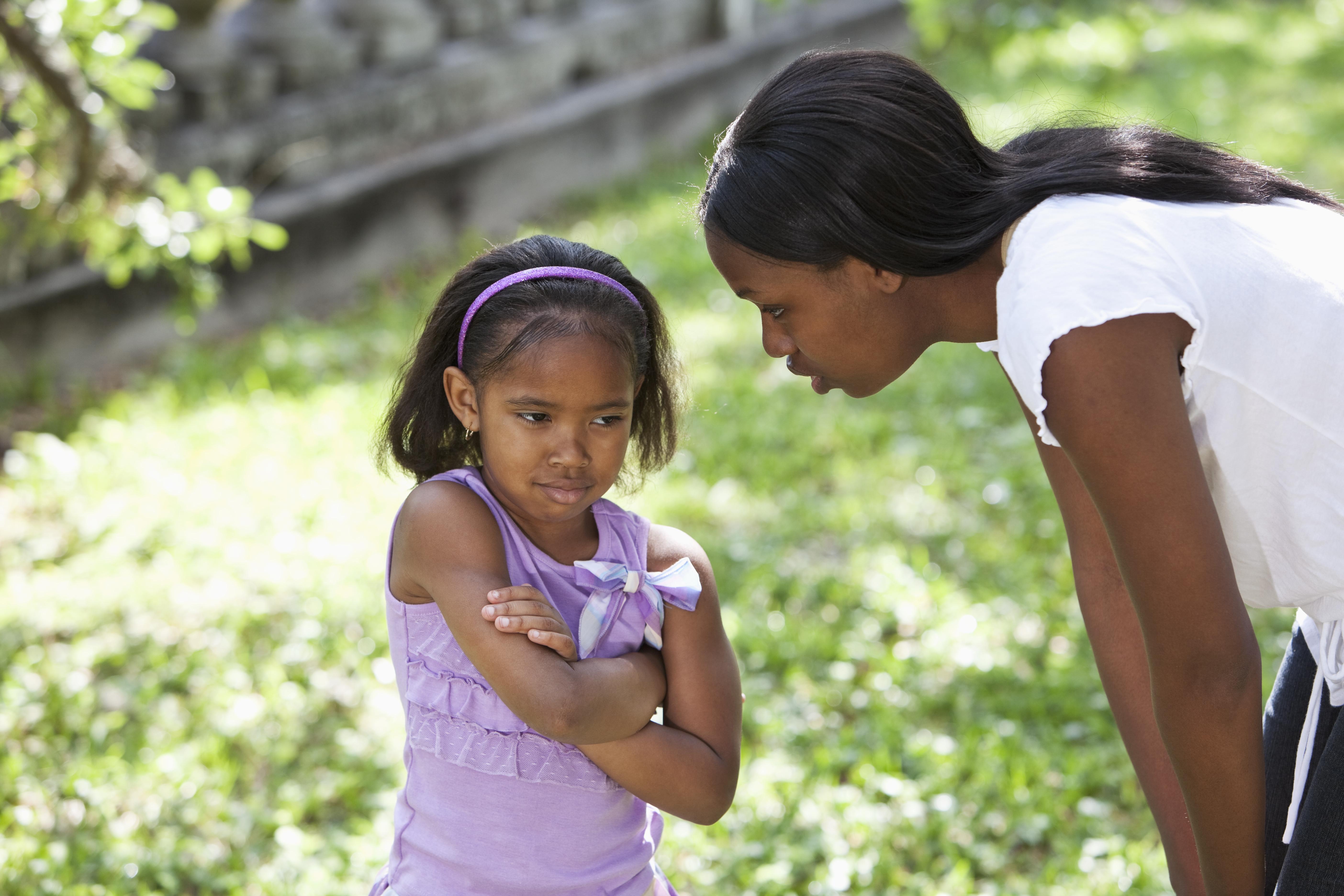 African American mother disciplining daughter