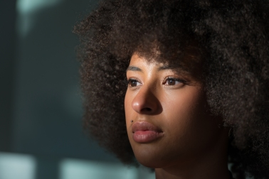 Young Black Female Is Looking Aside, Portrait