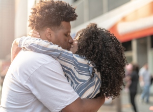 Young Couple Embracing at city