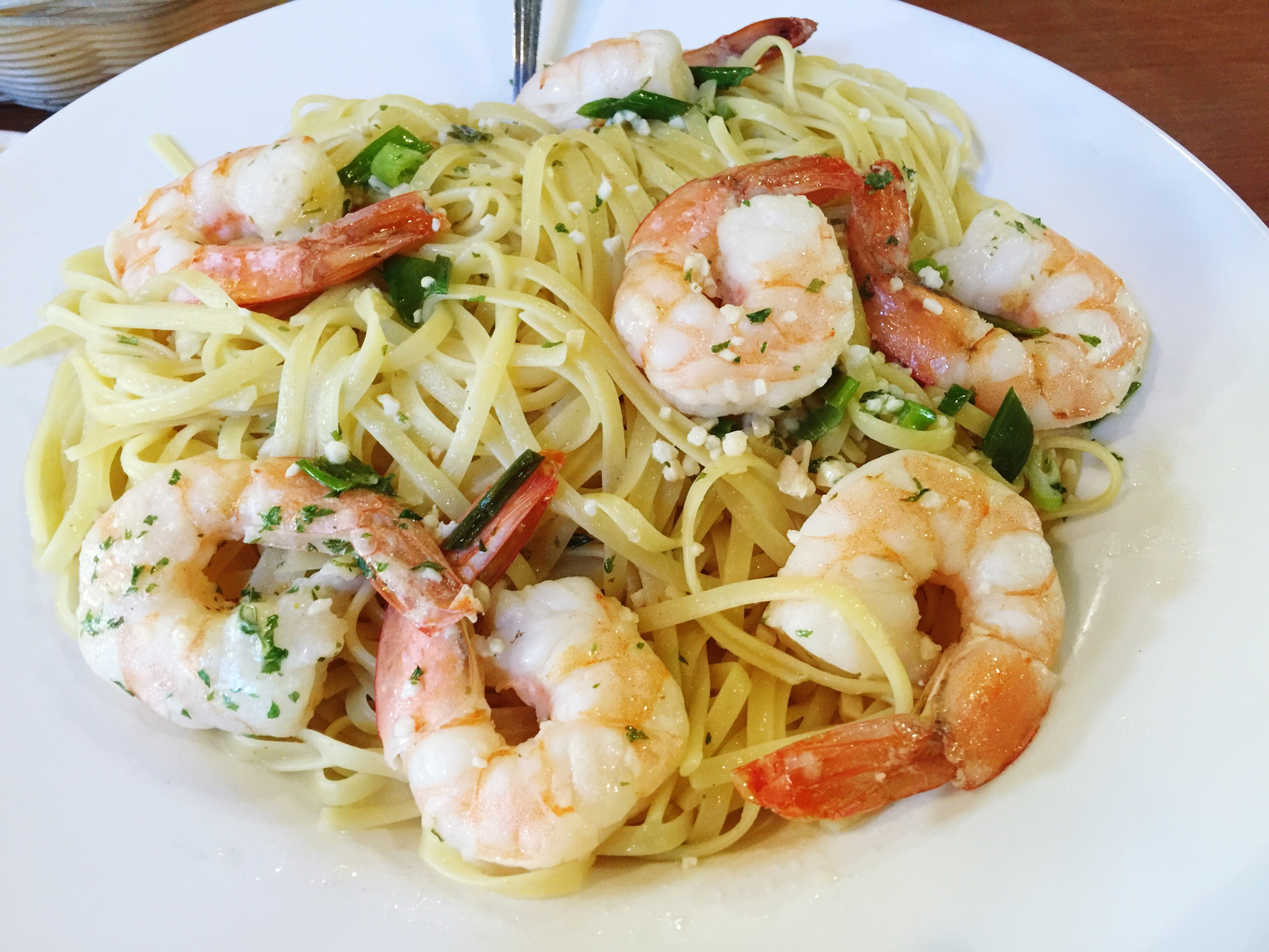 High Angle View Of Pasta And Shrimps In Plate On Table