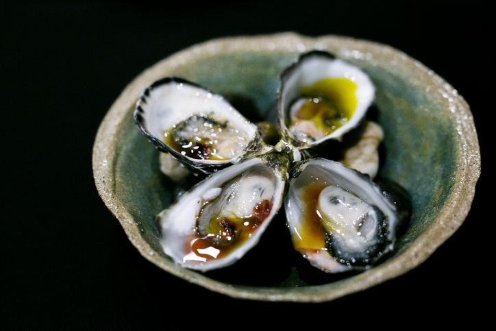 Luxury Cuisine, Oysters with Sauce in blackground
