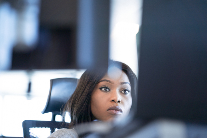 Serious businesswoman working at desk in office