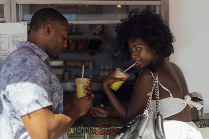 Young couple having a drink at a kiosk