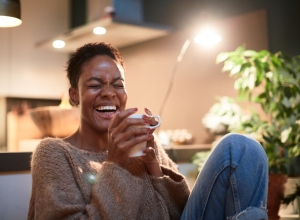 Woman at home enjoying a cup of coffee.