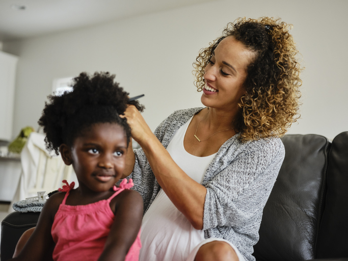 Mom and Daughter Doing Hair