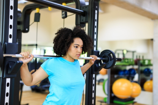 African woman practicing in gym