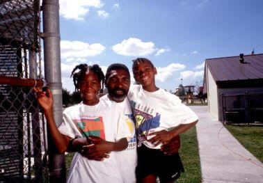 Tennis players Venus and Serena Williams pose in 1991 in Compton
