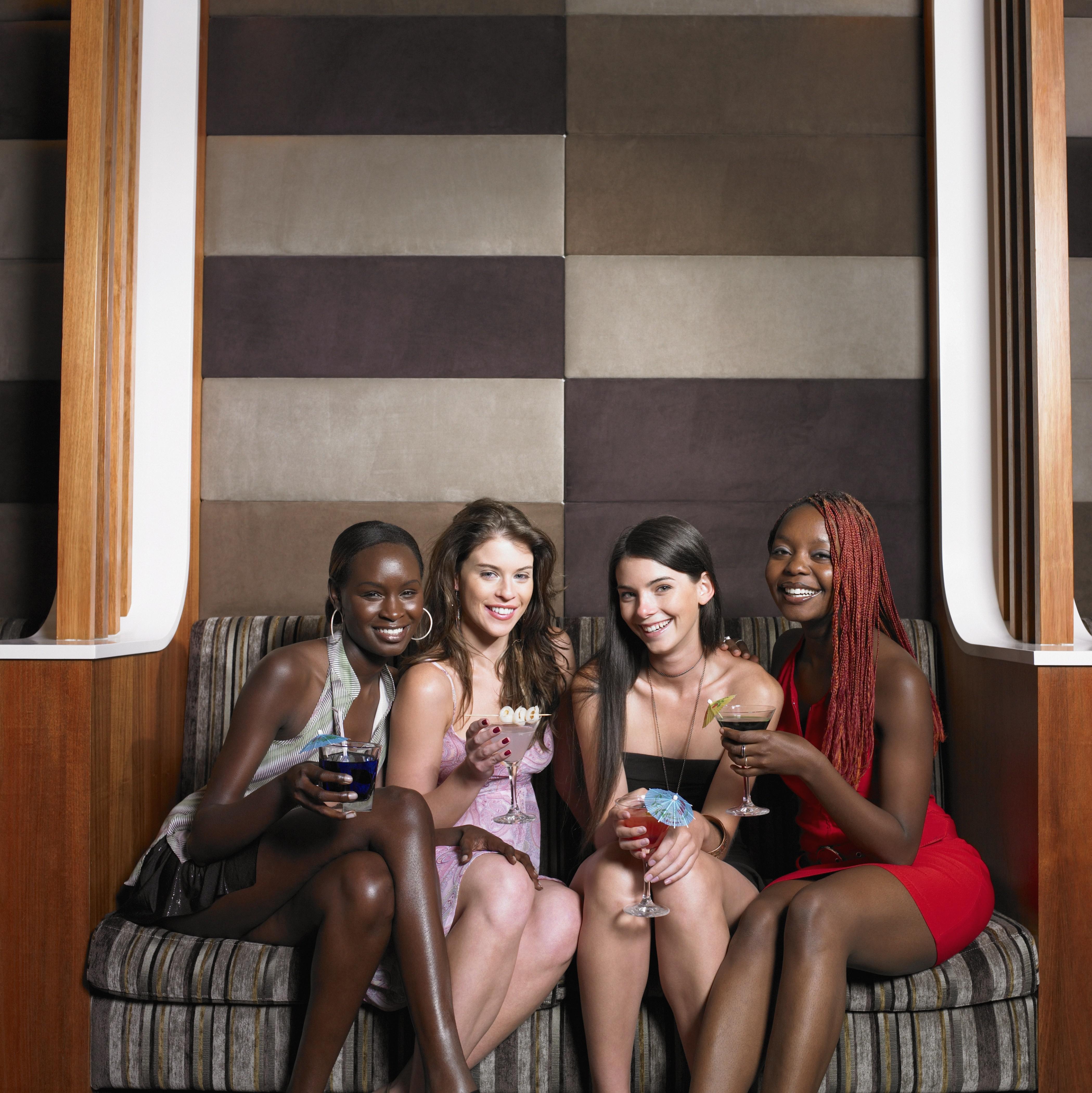 Group of female friends having drinks