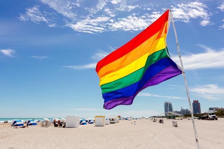Rainbow flag on the beach in South Beach, Miami, USA