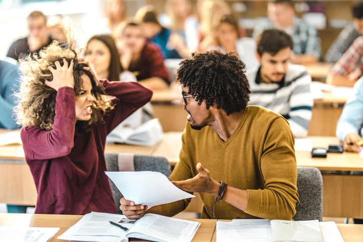 Frustrated college couple arguing on a class at school.