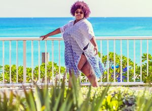 Plus size African American Woman in Paradise, beautiful costal day at the beach