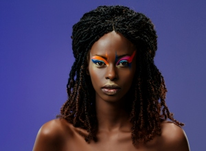 Beauty, fashion portrait. Original looks. Beautiful, lovely and sensual young african girl. Attractive African ethnicity, slim women.