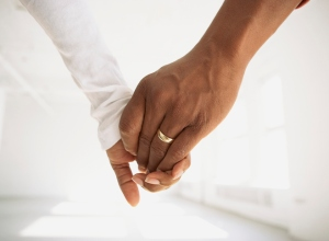 Couple holding hands in empty room