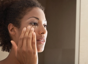 Woman Applying Makeup - stock photo