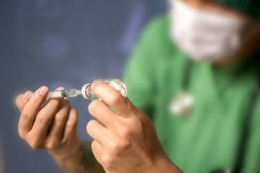 Doctor hold syringe prepare for injection,Epidural analgesia,Epidural nerve block, spinal block,Health care concept.