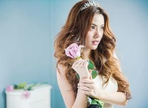 Beautiful Bride Holding Rose Standing At Home