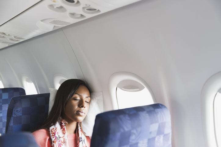 Woman sleeping in airplane