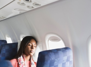 Woman sleeping in airplane