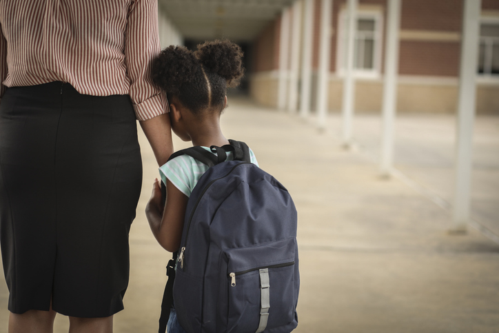 Elementary, African American girl with mom on first day of school.