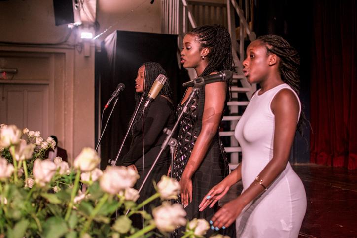 Choir Singing On Microphones At Church