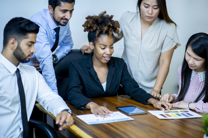 Diverse group of businesspeople at a conference table
