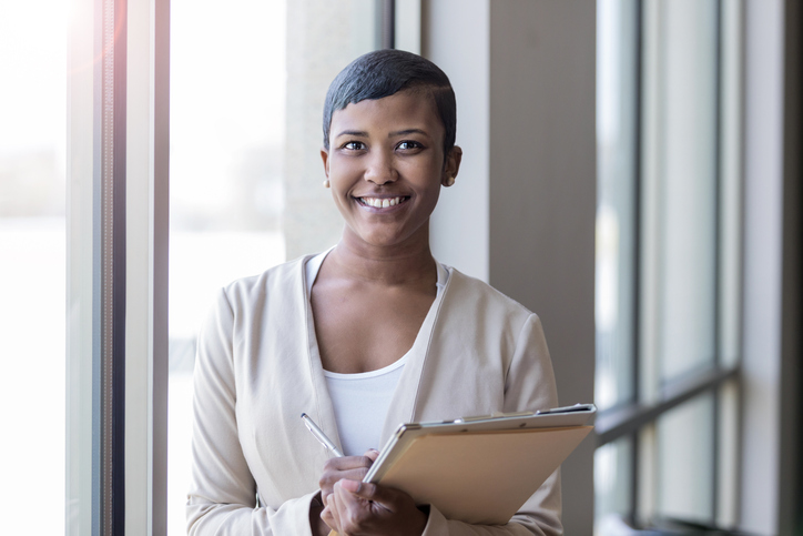 Confident businesswomen smiles at the camera