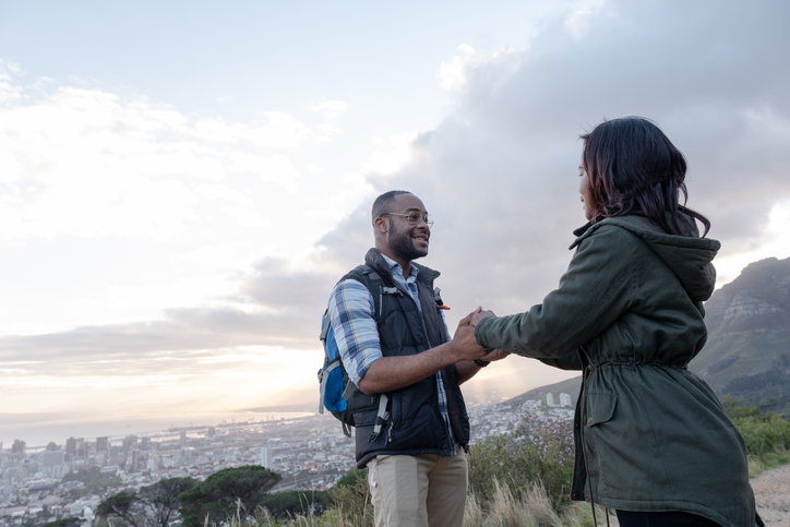 Smiling couple holding hands on Table Mountain