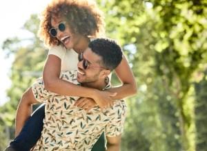 Cheerful young couple enjoying piggyback ride