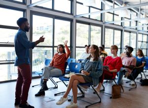Professor explaining young multi-ethnic students