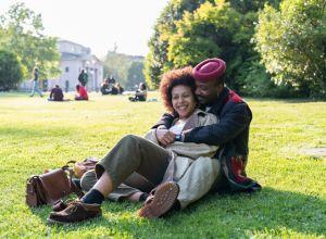 Loving couple hugging on grass, Milan, Italy