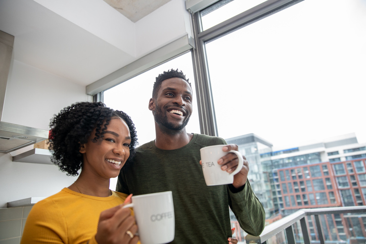 African American couple having a morning coffee together in the kitchen