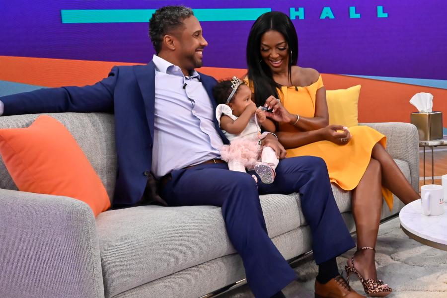 Kenya Moore men holding daughter