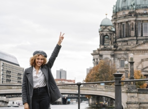 Portrait of cheerful tourist woman in the city with Berlin Cathedral in background, Berlin, Germany