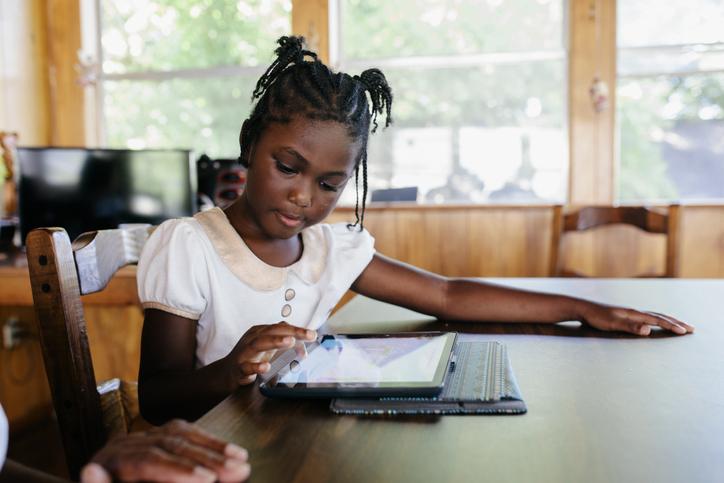 Young black child doing homework