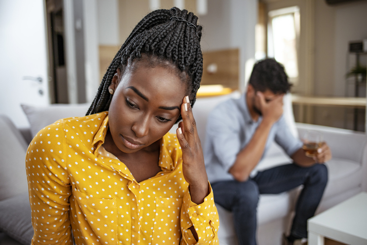 Black woman and man after quarrel at home