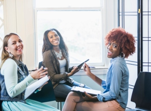 Multiracial business meeting, black woman in charge
