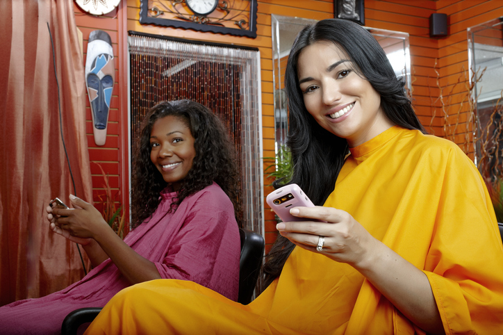 Friends with cell phones in beauty salon