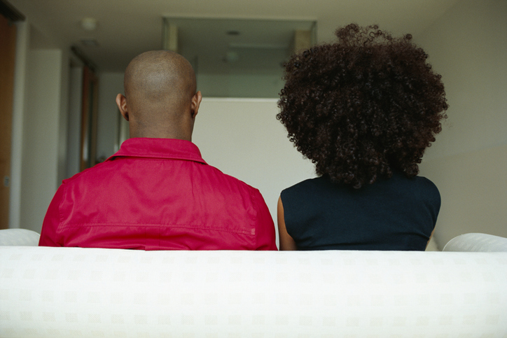 Backs of Couple Sitting on Couch