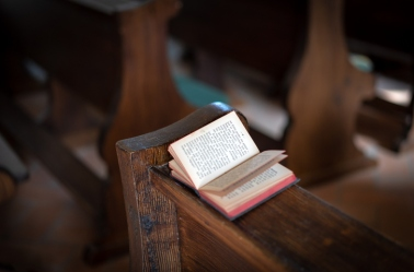 High Angle View Of Book On Pew At Church