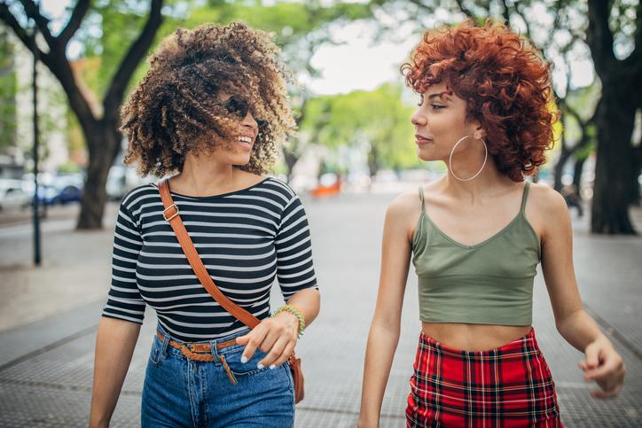 Two young women walking outdoors
