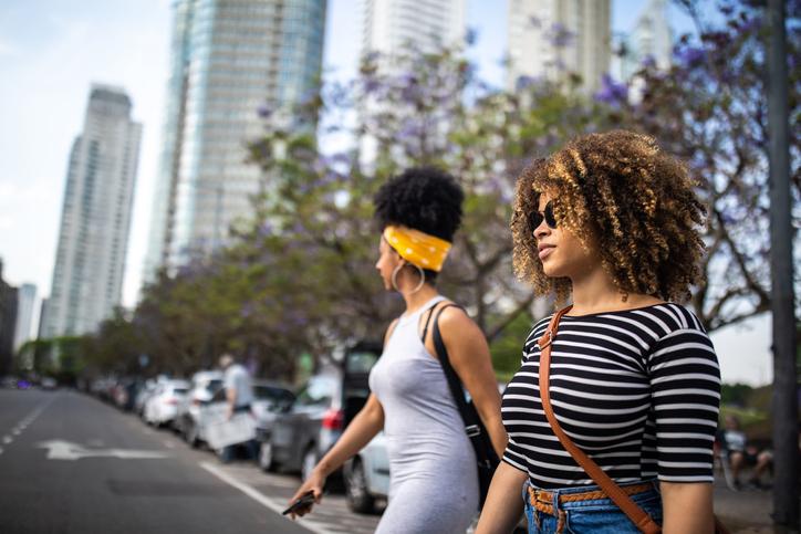 Confident women crossing street on zebra crossing