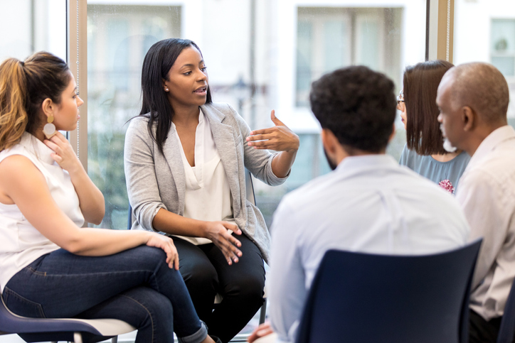 Counselor speaks candidly during group session