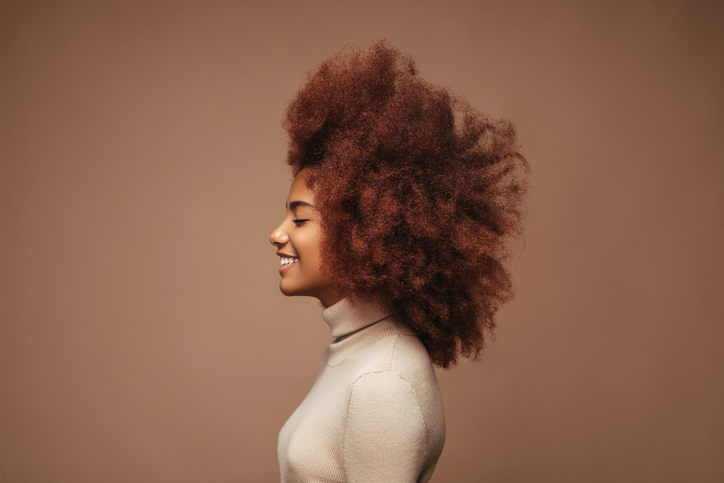 Photo of cheerful curly girl with positive emotions