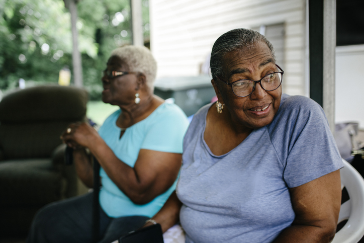 Two senior black women at family cookout