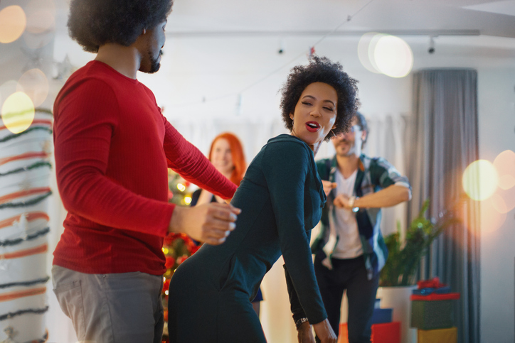 Young couple dancing at party.