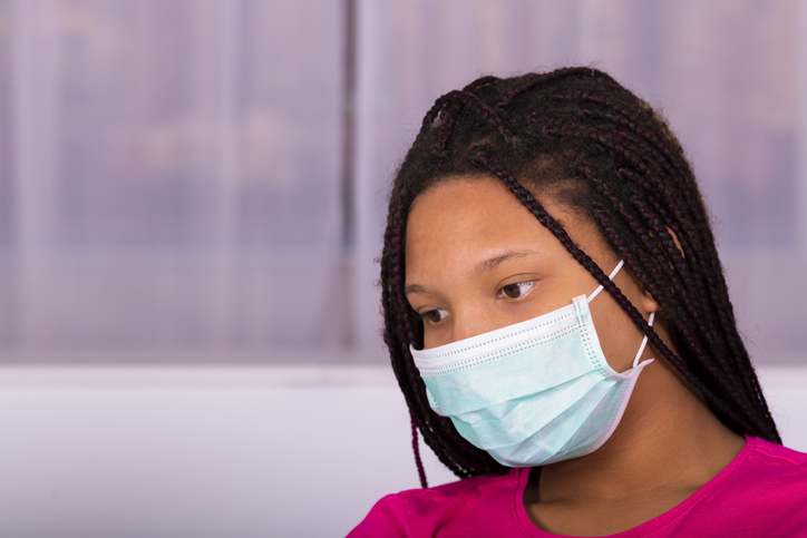 Close-Up Of Teenage Girl With Braided Hair Wearing Mask