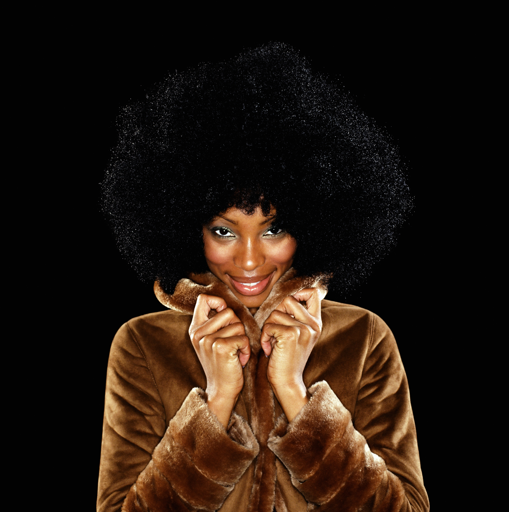 Young woman in fur coat with afro