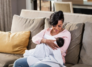 African-American mother nursing baby boy